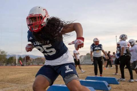 Liberty's inside linebacker Malachi Maika-Lepisi Asuega runs drills during football practice at ...