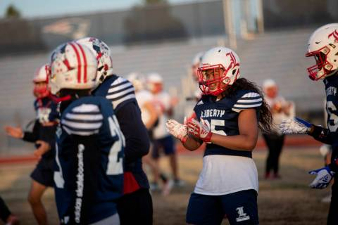 Liberty's inside linebacker Malachi Maika-Lepisi Asuega, right, claps as the team moves on from ...