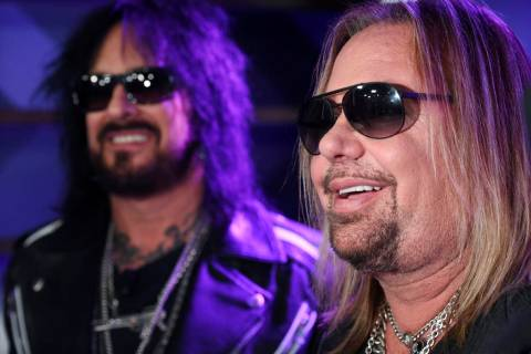 Nikki Sixx, left, and Vince Neil of Motley Crue are interviewed following a news conference to ...