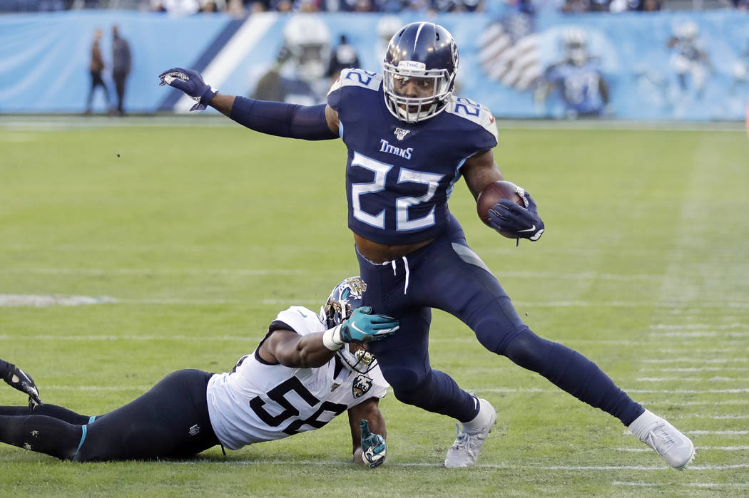 Tennessee Titans running back Derrick Henry (22) gets past Jacksonville Jaguars linebacker Quin ...