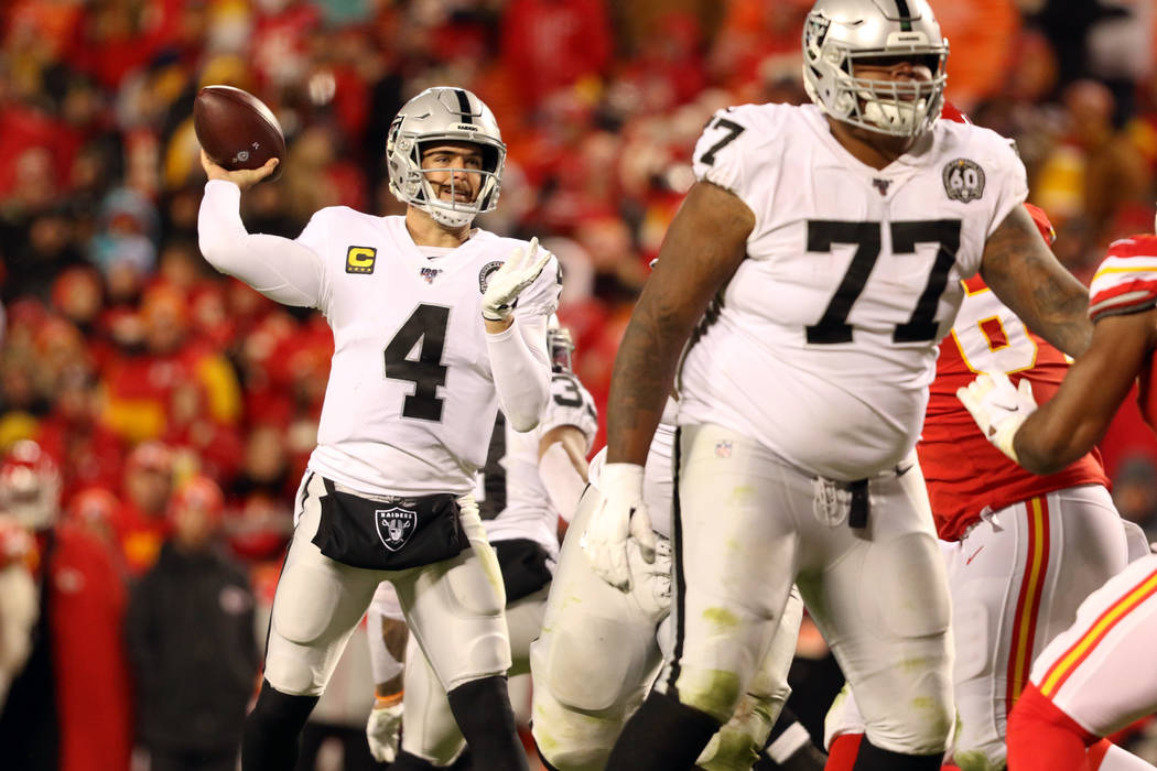 Oakland Raiders quarterback Derek Carr (4) throws the football as offensive tackle Trent Brown ...