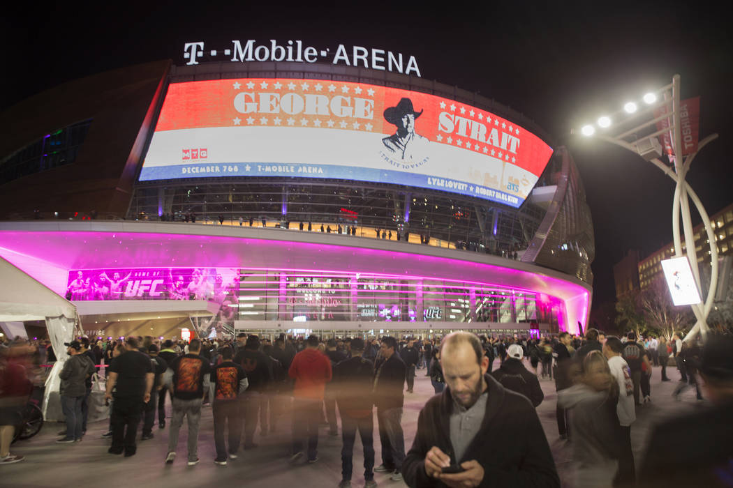 Concertgoers line up outside T-Mobile Arena before the start of the Metallica show on Monday, N ...