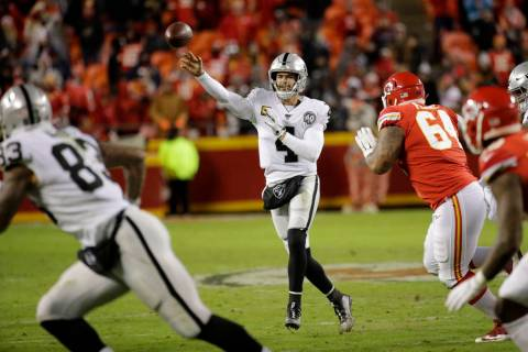 Oakland Raiders quarterback Derek Carr (4) throws a pass as Kansas City Chiefs defensive tackle ...
