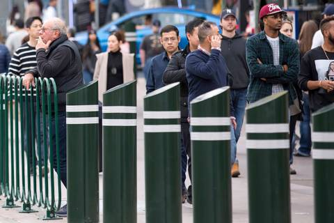 People walk past safety bollards on the Vegas Strip. (Las Vegas Review-Journal)