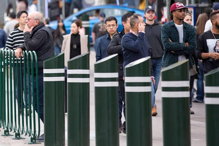 People walk past safety bollards on the Vegas Strip. (Las Vegas Review-Journal)