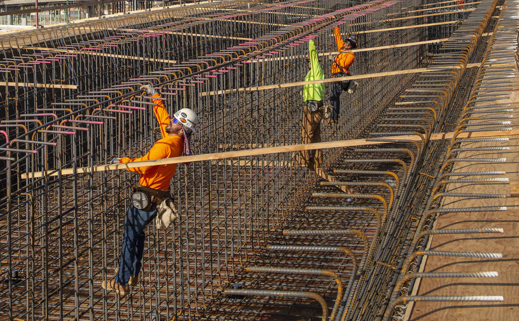 Steel rods are put in during the construction on the Centennial Bridge linking the eastbound 21 ...