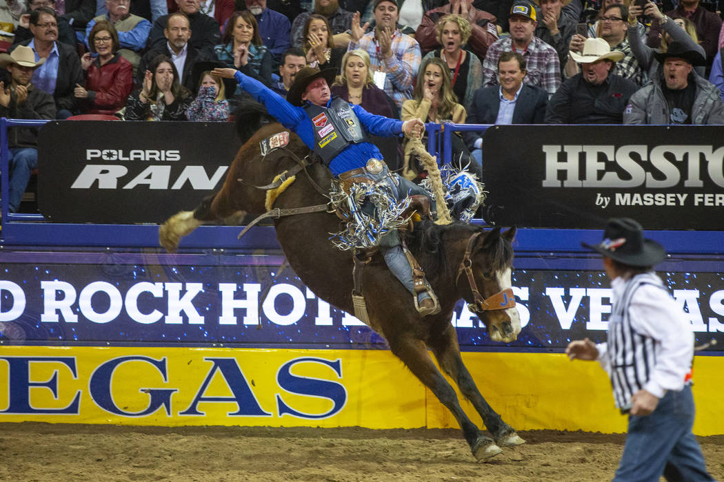Spencer Wright of Milford, Utah, rides Hell on Hooves in Saddle Bronc Riding during the third g ...
