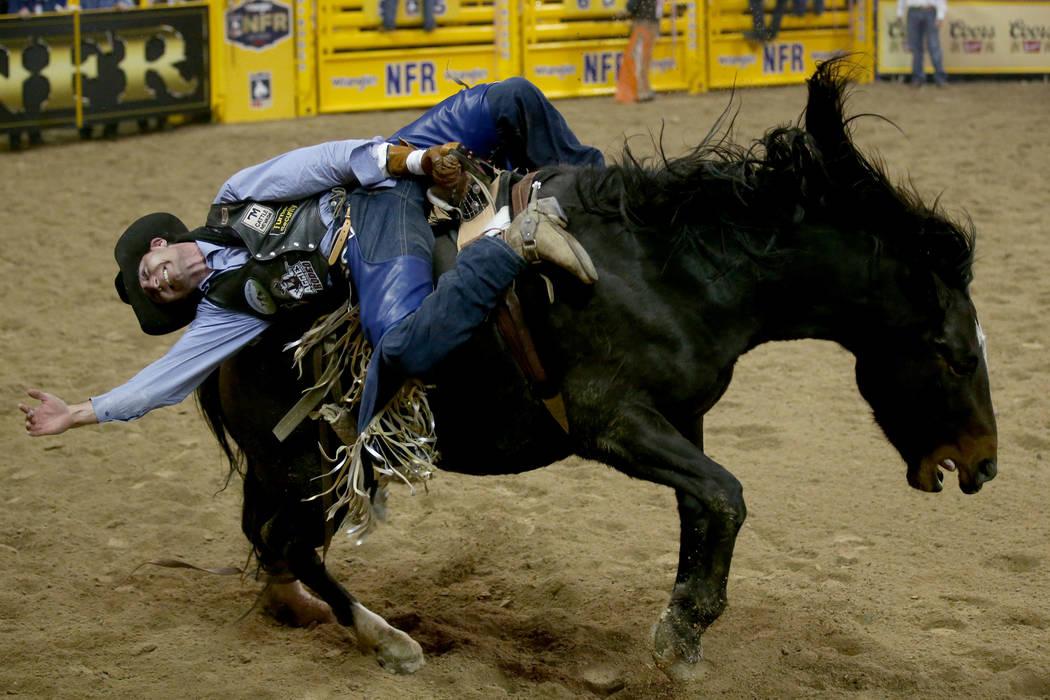 Trenton Montero of Winnemucca rides Prairie Rose in Bareback Riding during the second go-around ...