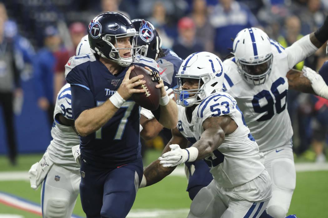 Indianapolis Colts defensive end Ben Banogu (52) sacks Tennessee Titans quarterback Ryan Tanneh ...