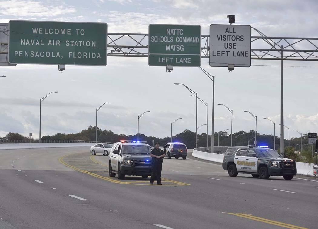 Police vehicles block the entrance to the Pensacola Air Base, Friday, Dec. 6, 2019 in Pensacola ...