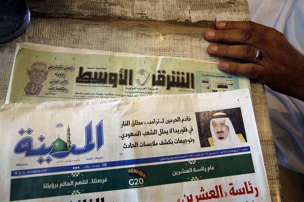 Saudi daily Al-Madina newspaper fronted by a picture of Saudi King Salman is displayed at a cof ...