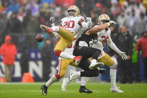 San Francisco 49ers free safety Jimmie Ward (20) looses control of the ball against Baltimore R ...