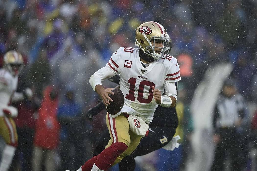 San Francisco quarterback Jimmy Garoppolo runs the ball against the Baltimore Ravens in the fir ...