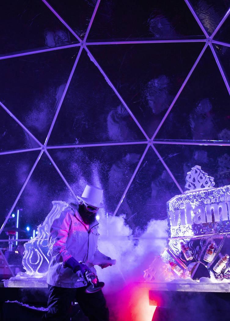 Marco Villareal, who owns The Vegas Iceman, does a live ice cutting performance at Intersect Fe ...