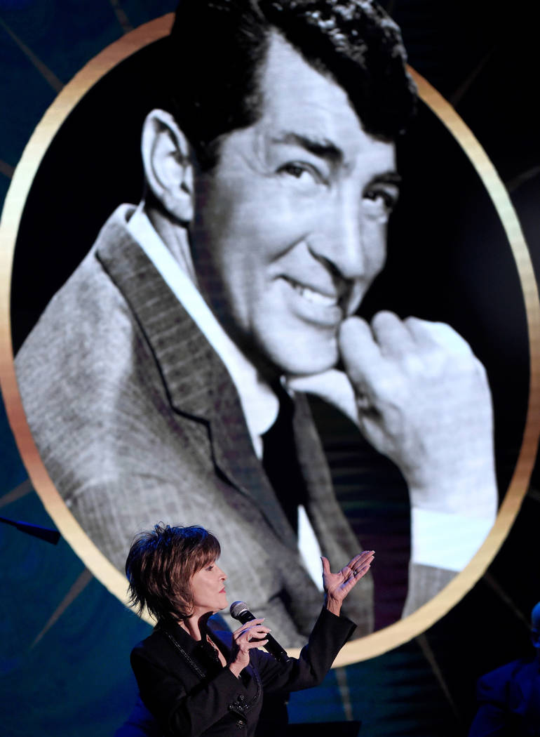 """A portrait of her father, Dean Martin, looms large during Deana Martin's 2017 """"Deana Sings Di ..."""