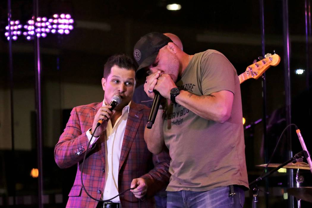 """Mondays Dark founder Mark Shunock and UFC legend Randy Couture perform """"A Hard Day's Night"""" at ..."""