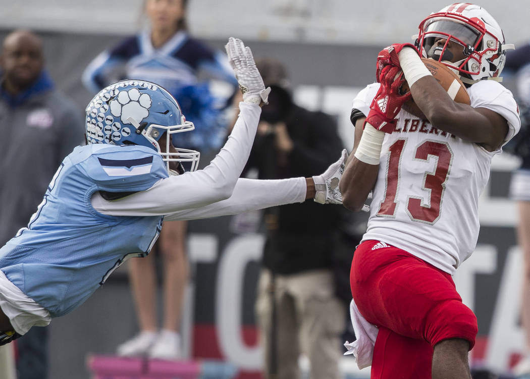 Liberty junior wide receiver Corey Hebert (13) beats Centennial junior cornerback Tyrone McCoy ...