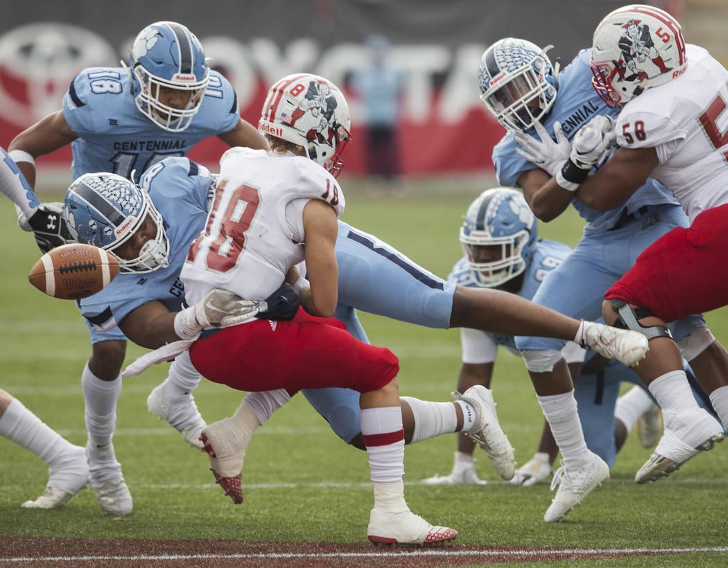Centennial senior Thomas Lane (8) hits Liberty junior quarterback Daniel Britt (18) causing a f ...