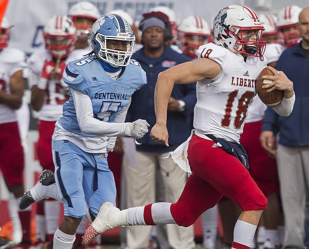 Liberty junior quarterback Daniel Britt (18) breaks a big run down the sideline past Centennial ...