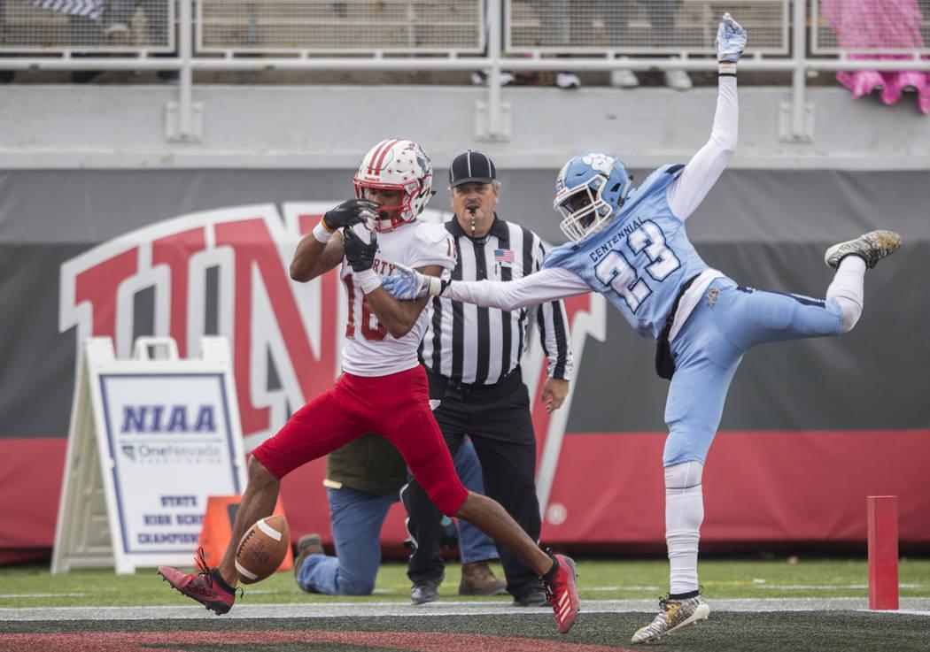 Centennial junior Jordan McGilbra (23) breaks up a pass to Liberty senior wide receiver Maurice ...