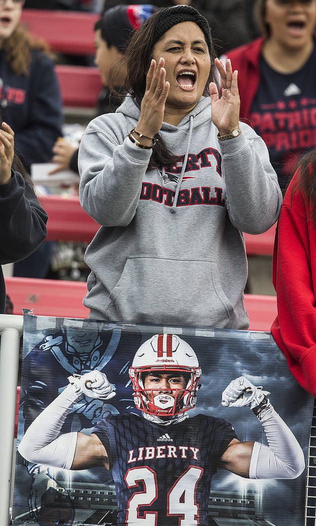 Liberty fans cheer for the Patriots during their Class 4A state football championship game agai ...