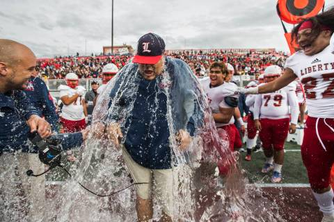 Liberty coach Rich Muraco is given a Gatorade bath after defeating Centennial 50-7 to win the C ...