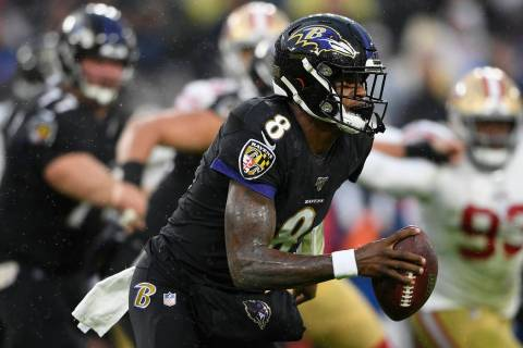 Baltimore Ravens quarterback Lamar Jackson (8) looks to pass the ball in the first half of an N ...