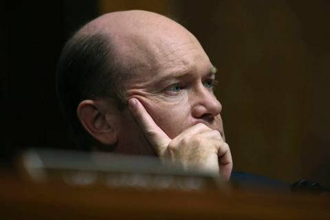 Sen. Chris Coons, D-Del., listens to testimony from Christine Blasey Ford during a Senate Judic ...