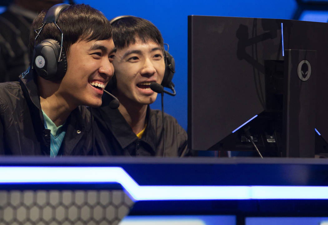 "Ð? Duy Khánh, known as ""Levi,"" left, and Zeng Zhan-Ran, known as ""1996 ..."