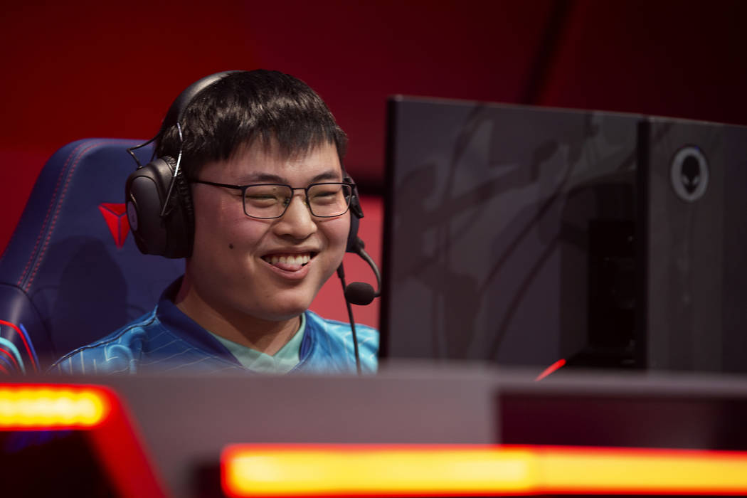 """Jian Zihao, who plays League of Legends professionally under the name """"Uzi,"""" smiles a ..."""