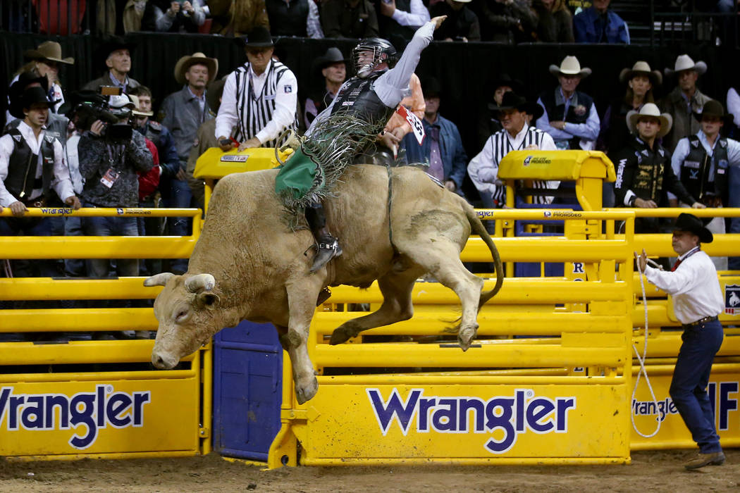 Jeff Askey of Athens, Texas, rides Yellow Fever during Bull Riding in the second go-around of t ...