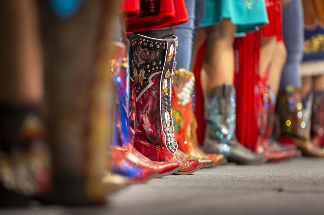 Boots worn and personally designed boots by Taylor Spears of Oklahoma join others on stage for ...