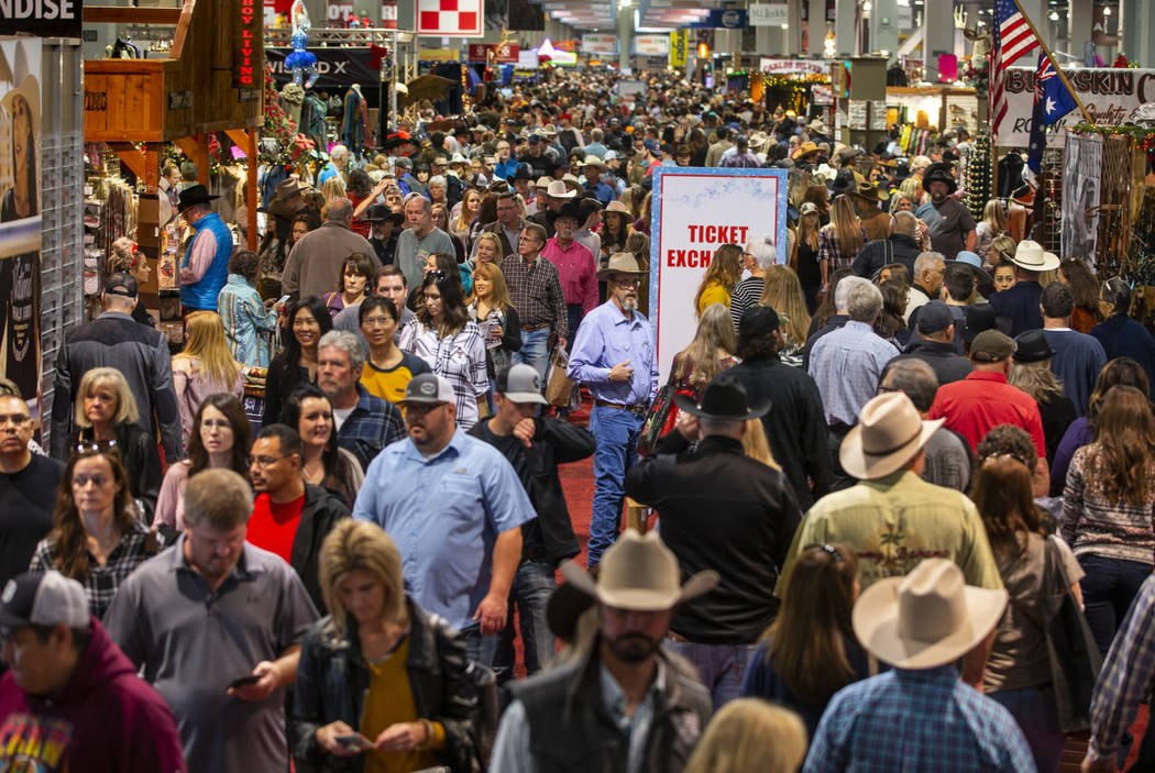 Shoppers wander about during Cowboy Christmas at the Las Vegas Convention Center on Saturday, D ...