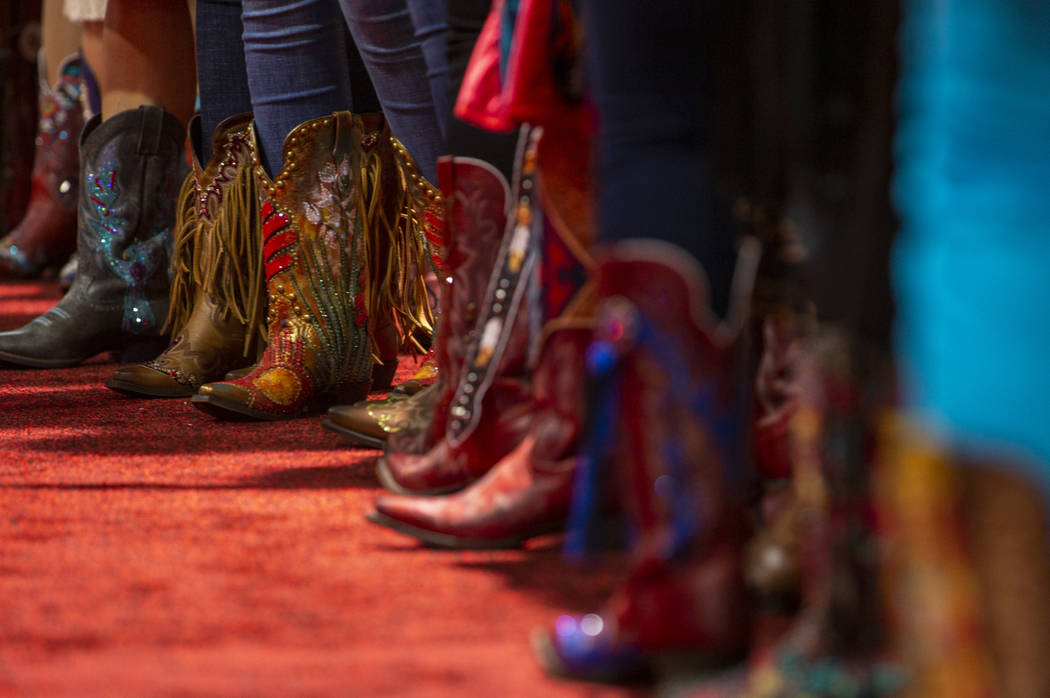 Contestants line up wearing their personally-designed boots for the Miss Rodeo America Justin B ...