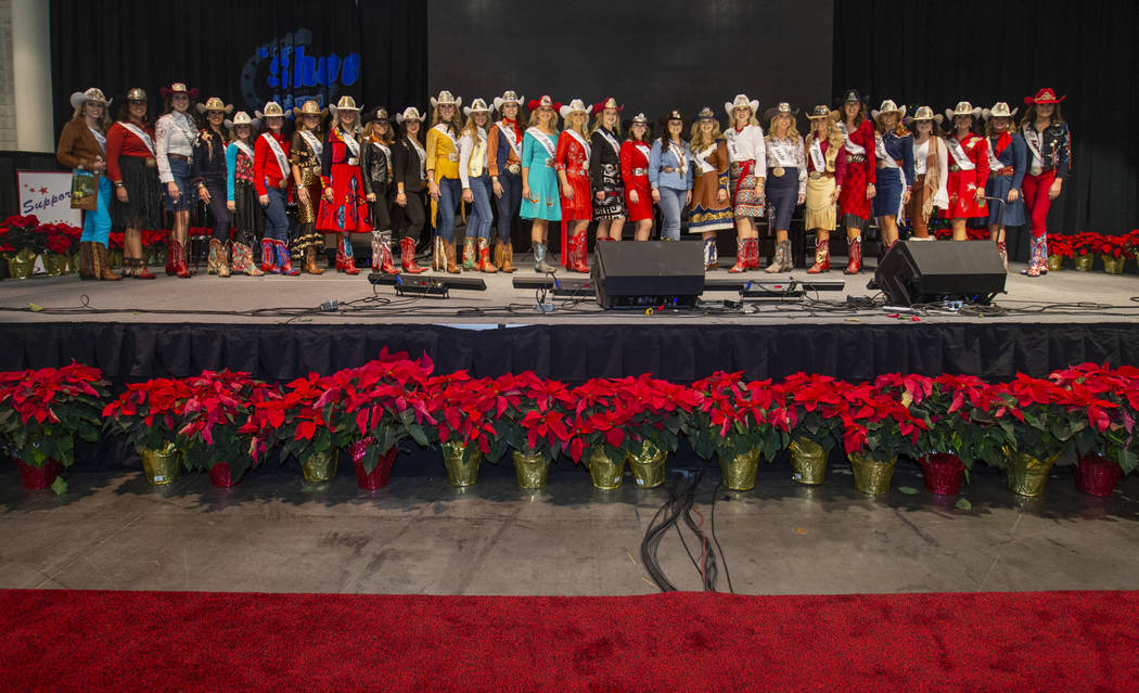 Contestants take the stage following the Miss Rodeo America Justin Boot Parade during Cowboy Ch ...