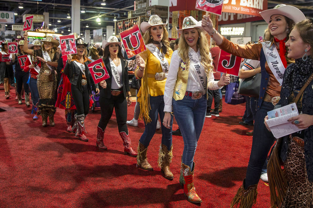 Contestants chant and walk in the Miss Rodeo America Justin Boot Parade during Cowboy Christmas ...