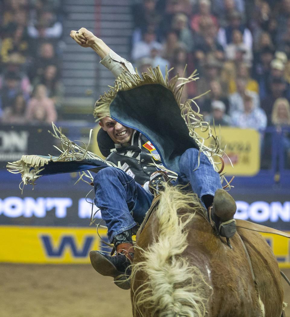 Orin Larsen of Inglis, Manitoba, rides Illegal smile in Bareback Riding during the third go-aro ...