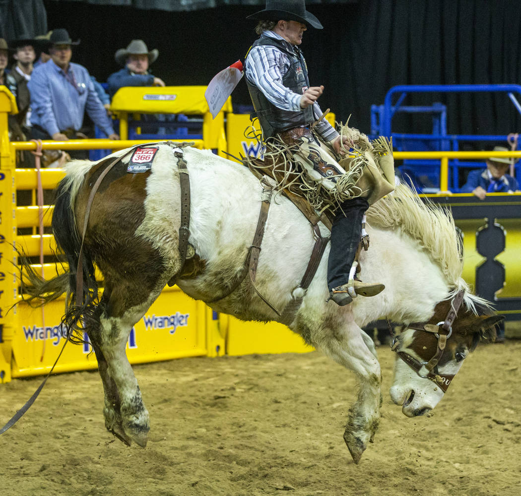 Chase Brooks of Deer Lodge, Mont., rides Lunatic Party to first place with a score of 90.0 in S ...