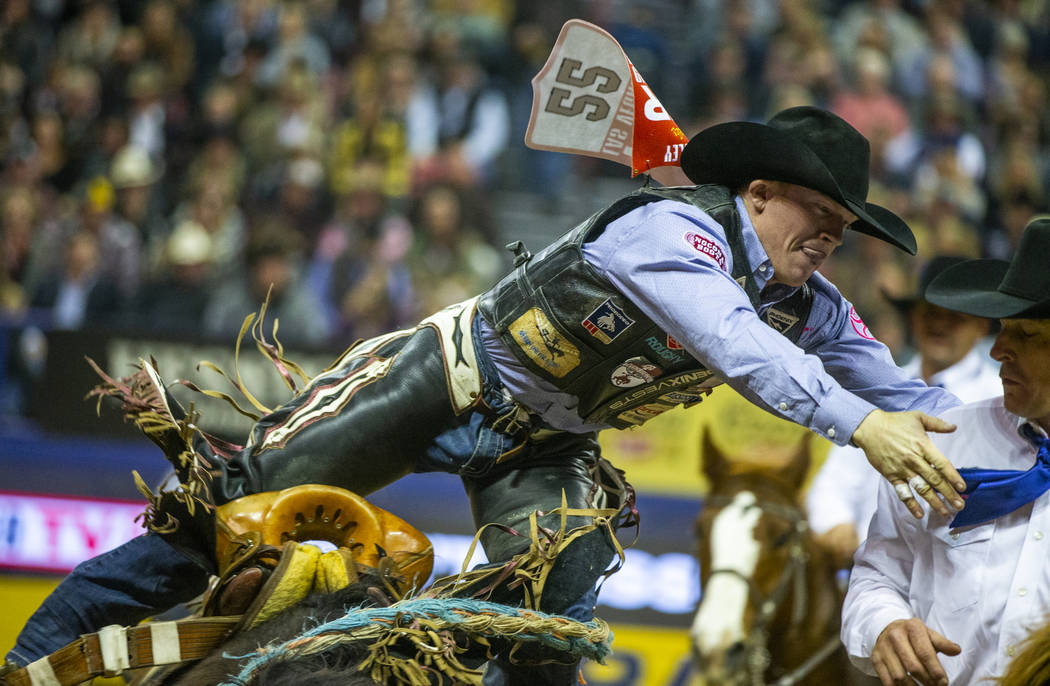 Jacobs Crawley of Boerne, Texas, hops off of Stampede Warrior in Saddle Bronc Riding during the ...