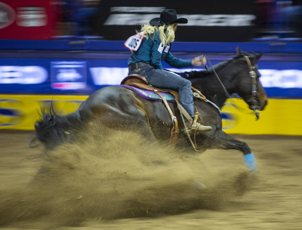 Amberleigh Moore of Salem, Oregon, nears another barrel while taking first place in Barrel Raci ...