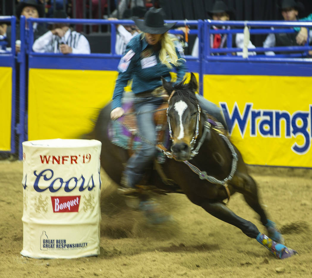 Amberleigh Moore of Salem, Oregon, navigates another barrel while taking first place in Barrel ...