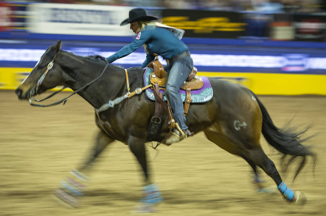Amberleigh Moore of Salem, Oregon, heads home while taking first place in Barrel Racing with a ...