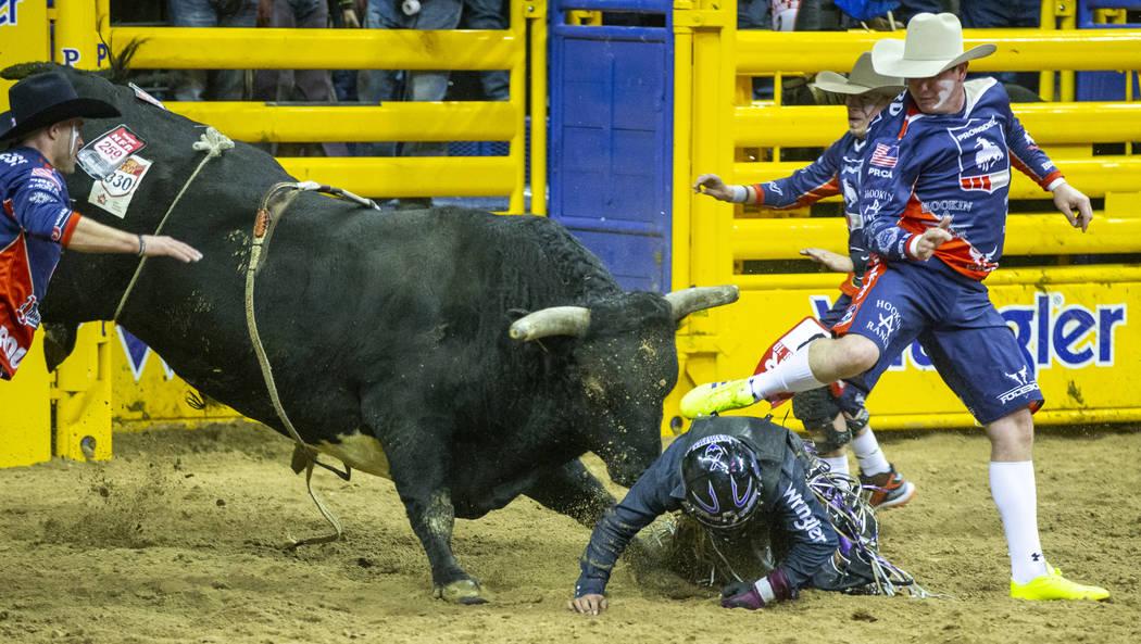 Daylon Swearingen of Rochelle, Georgia, is taken down by Hot And Ready as bullfighters attempt ...