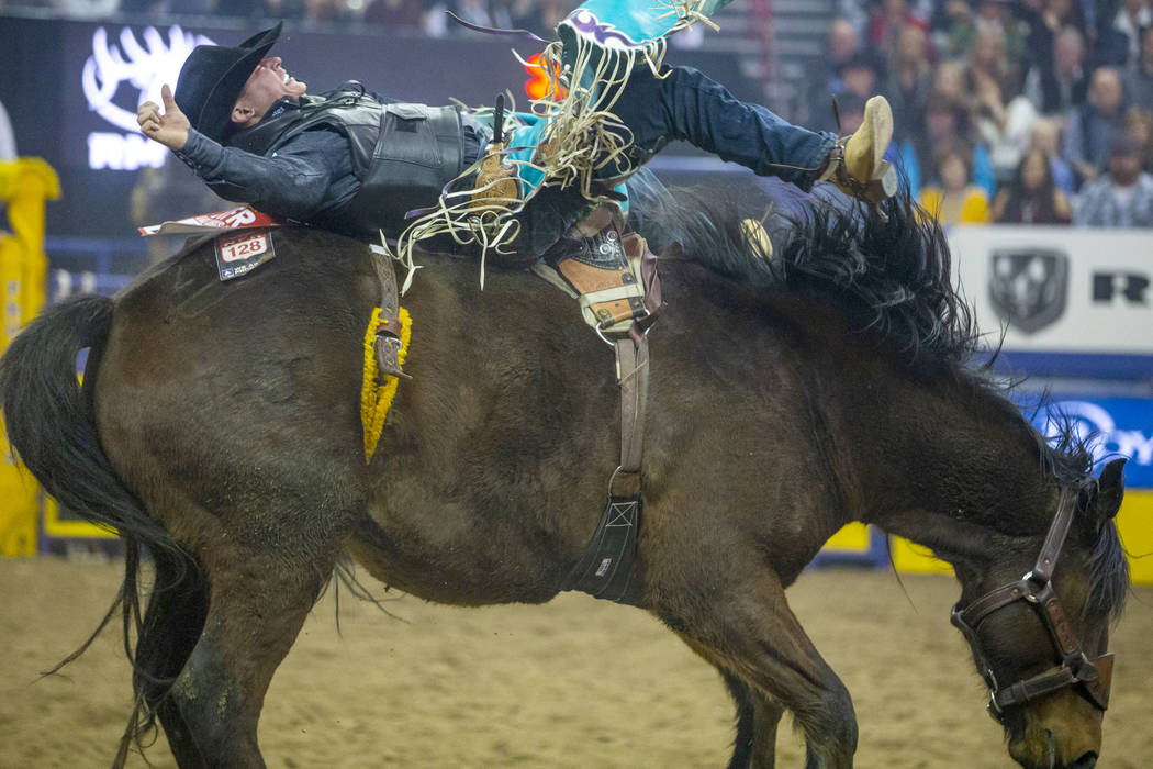 Tanner Aus of Granite Falls, Minn., rides Full Baggage to a first place score of 90 in Bareback ...