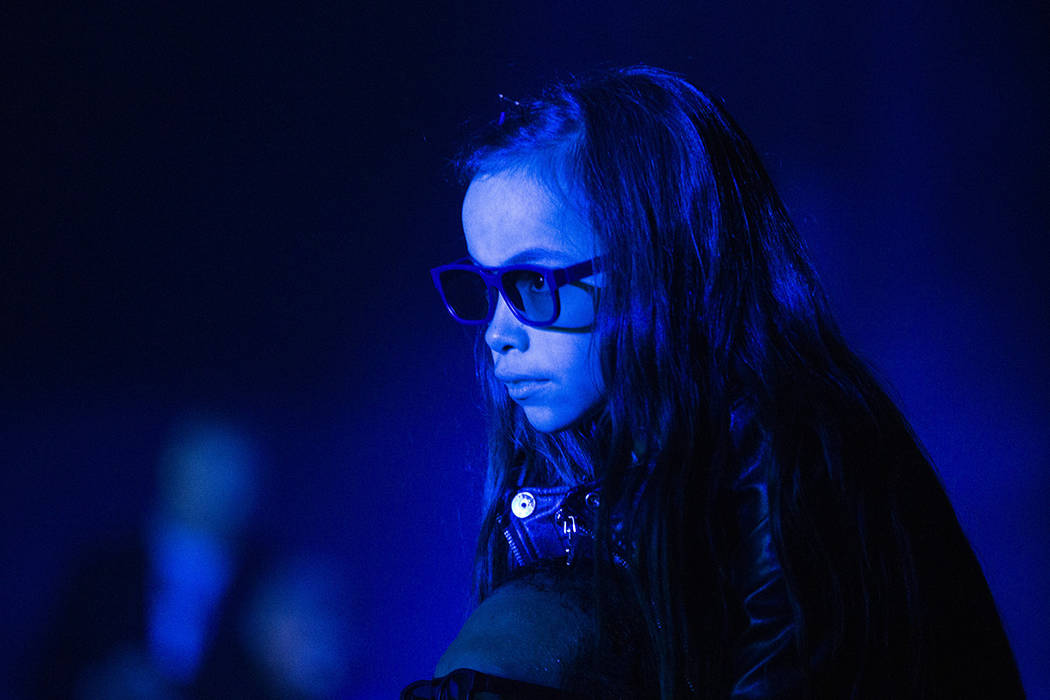 Alana Alcazar, 10, watches Flying Lotus's 3D performance from the shoulders of her dad, Alex Be ...