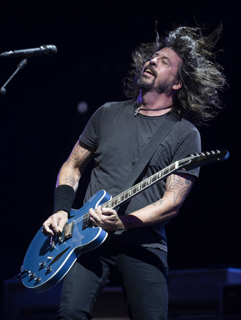 Dave Grohl of the Foo Fighters head bangs during the band's set on Saturday, Dec. 7, 2019, at I ...