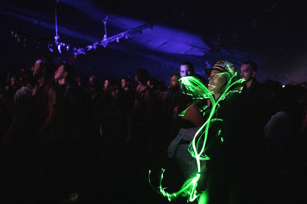 Amber Parucha of Las Vegas dances with an LED light whip as Toro Y Moi performs on Saturday, De ...