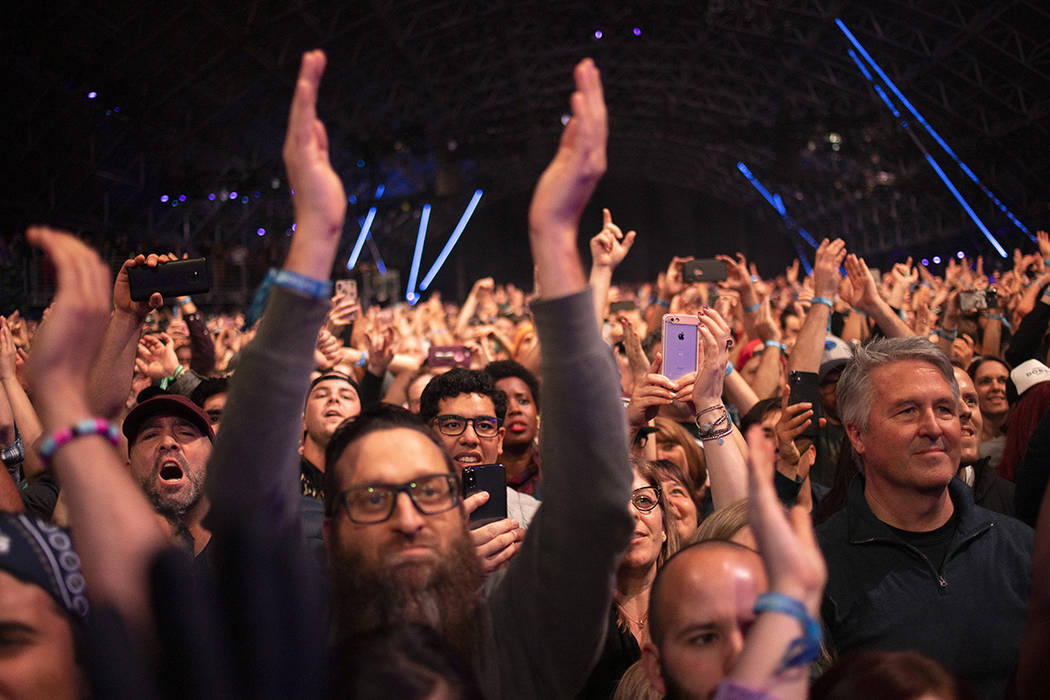 The crowd at Foo Fighters raises their hands for the band on Saturday, Dec. 7, 2019, at Interse ...