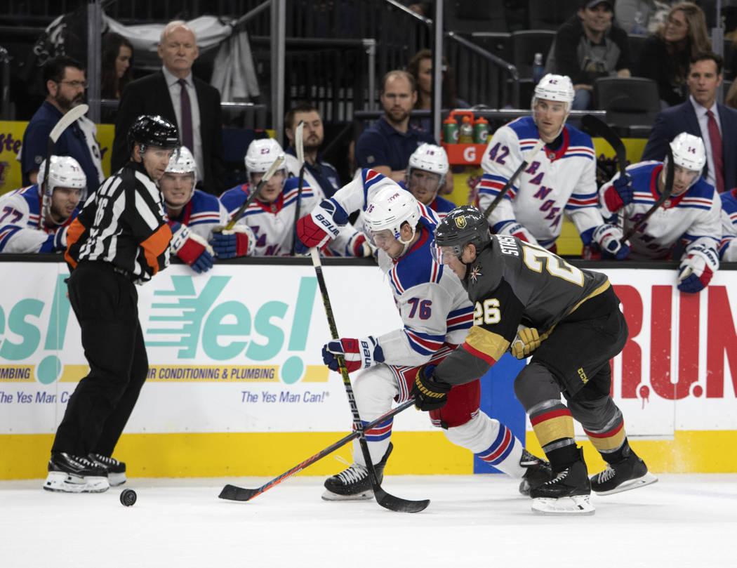 New York Rangers defenseman Brady Skjei (76) and Vegas Golden Knights center Paul Stastny (26) ...