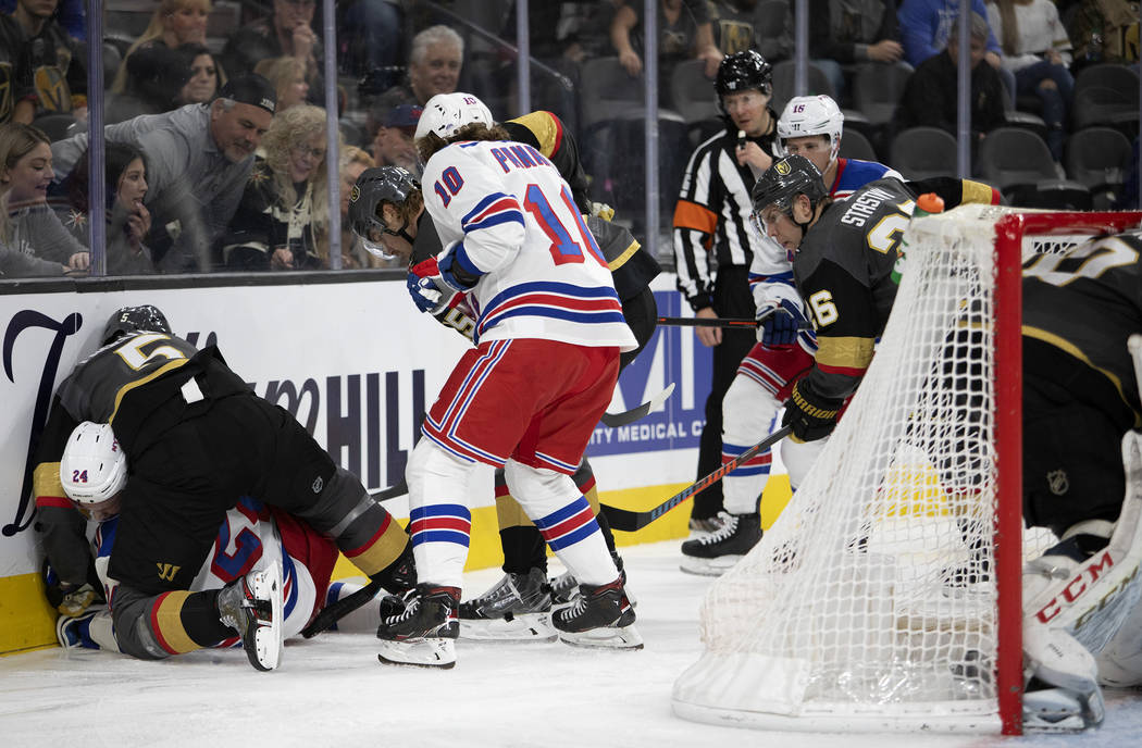 Vegas Golden Knights defenseman Deryk Engelland (5) fights New York Rangers right wing Kaapo Ka ...